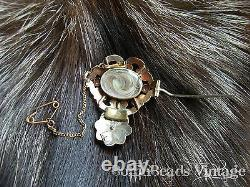 VICTORIAN GARNETS MOURNING BROOCH with human hair encased gold safety chain